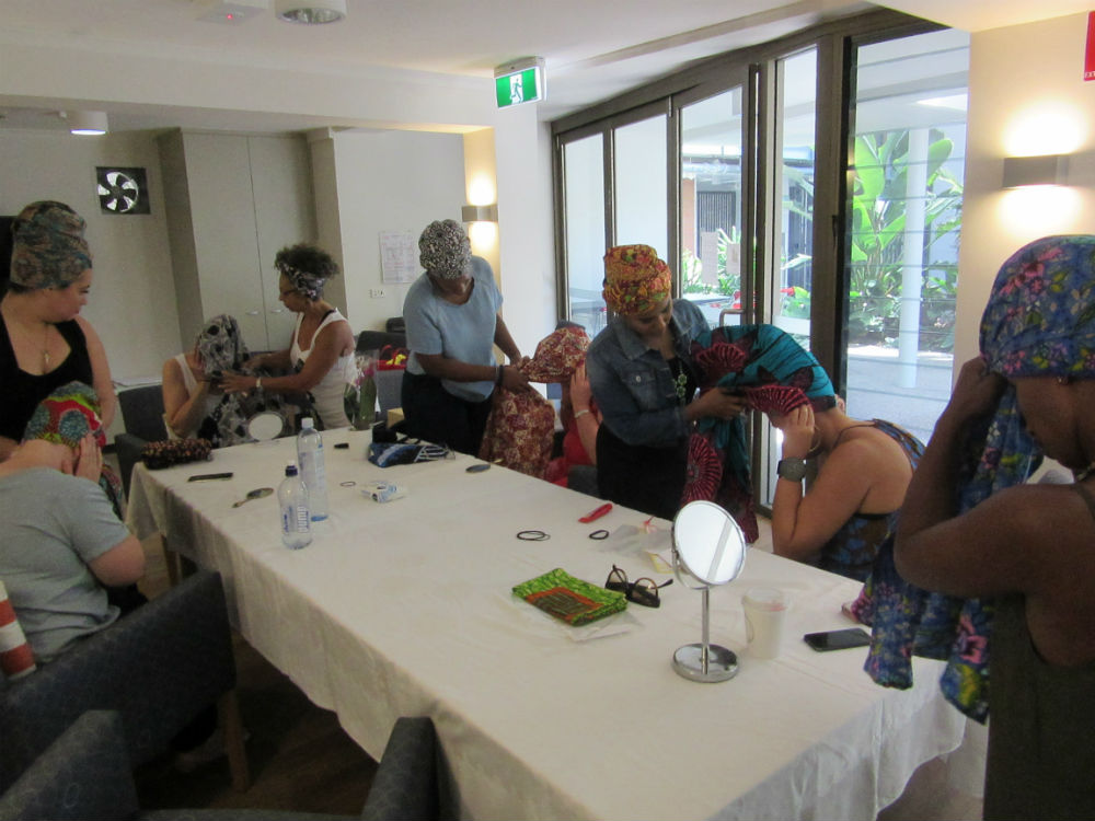 Our attendees having fun at our hands-on, interactive headwrap workshop.