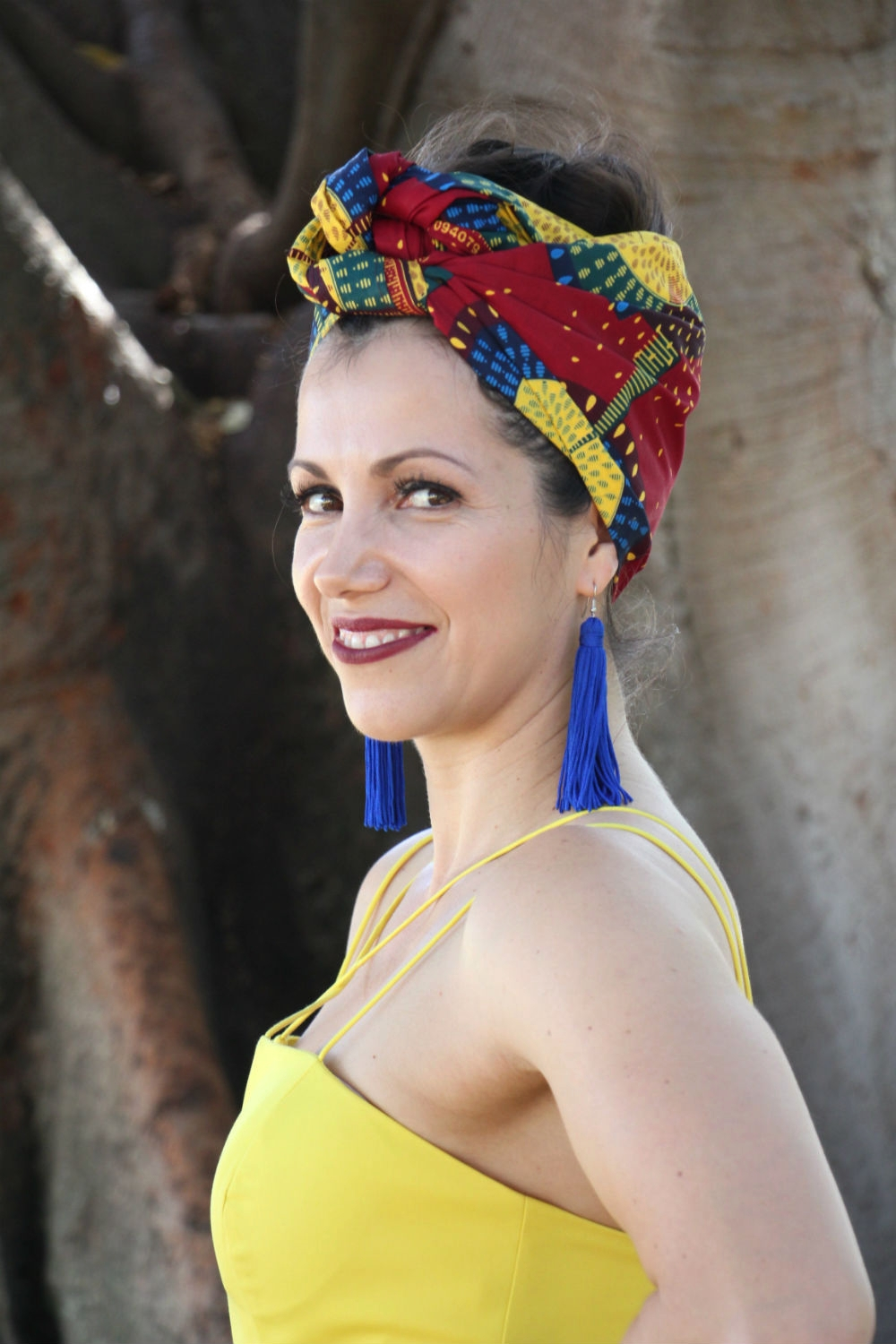 THE SS16 COLLECTION : A bright yellow dress and striking blue tassel earrings from Daniela's personal wardrobe highlights the rich design in headwrap  JENNIFER .
