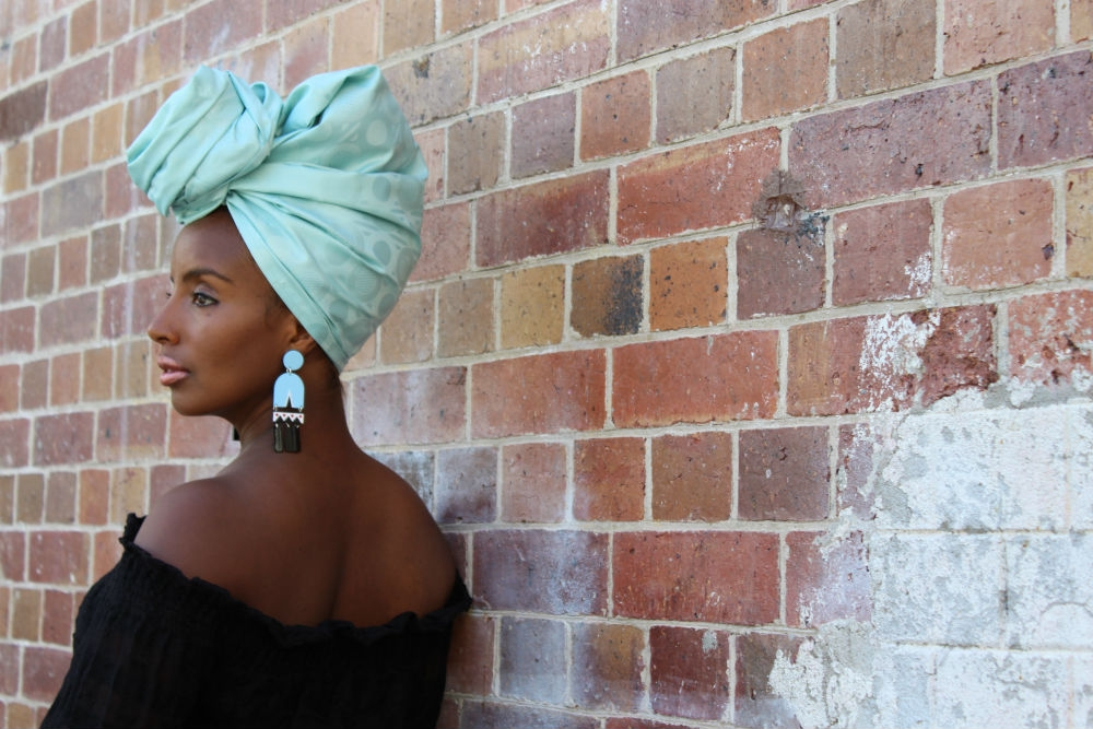 Yeni looks stunning in our limited edition African bazin headwrap design. We've named her TURQUOISE and teamed her with earrings from Melbourne based jewellery designer Ovazania.