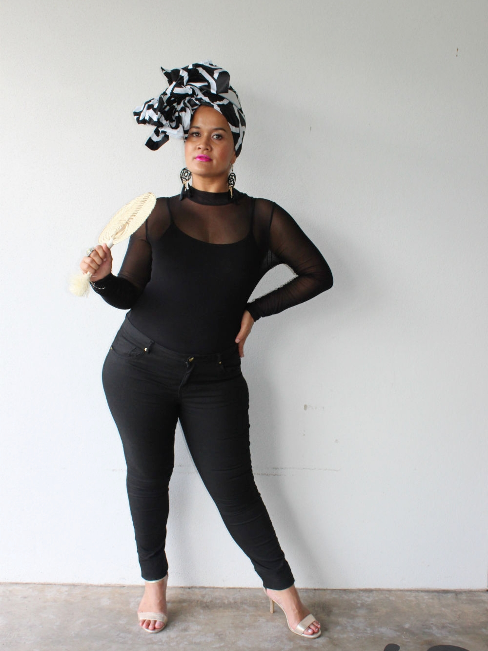 When Steph was given the mood board for our latest collection, she rummaged through her wardrobe and teamed HEADWRAP ZIG with this smart, casual outfit. The transparent bodysuit was the ideal touch to complete this look.