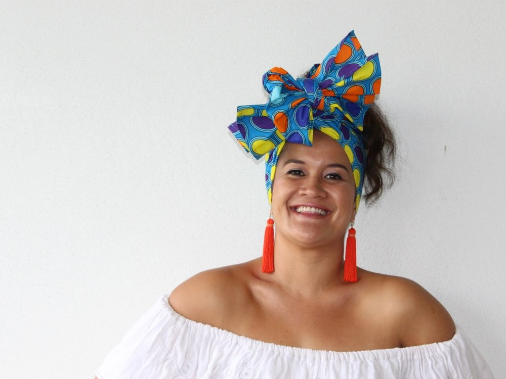 HEADWRAP LAEEKAH was teamed with a white ruffled off-the-shoulder top to emphasise the bright, bold colours in this design. Orange tassel statement earrings complete this look.
