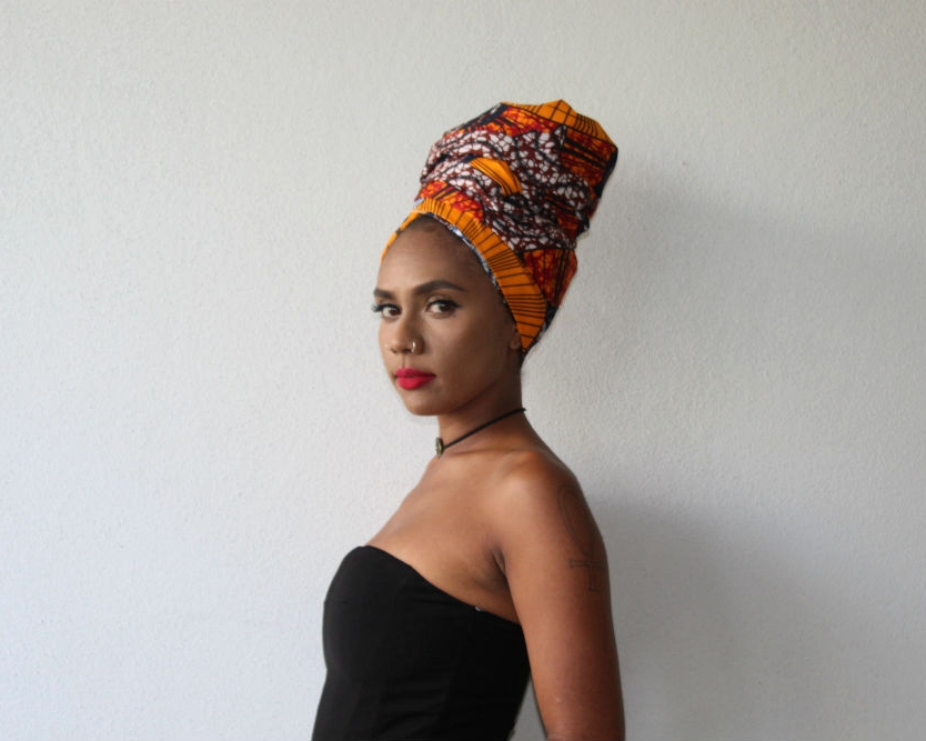 To capture the essence of royalty, we styled our ankara headwrap  BEHATI  in a high turban. Agnes teamed BEHATI with a strapless pants suit, creating a chic and elegant look.
