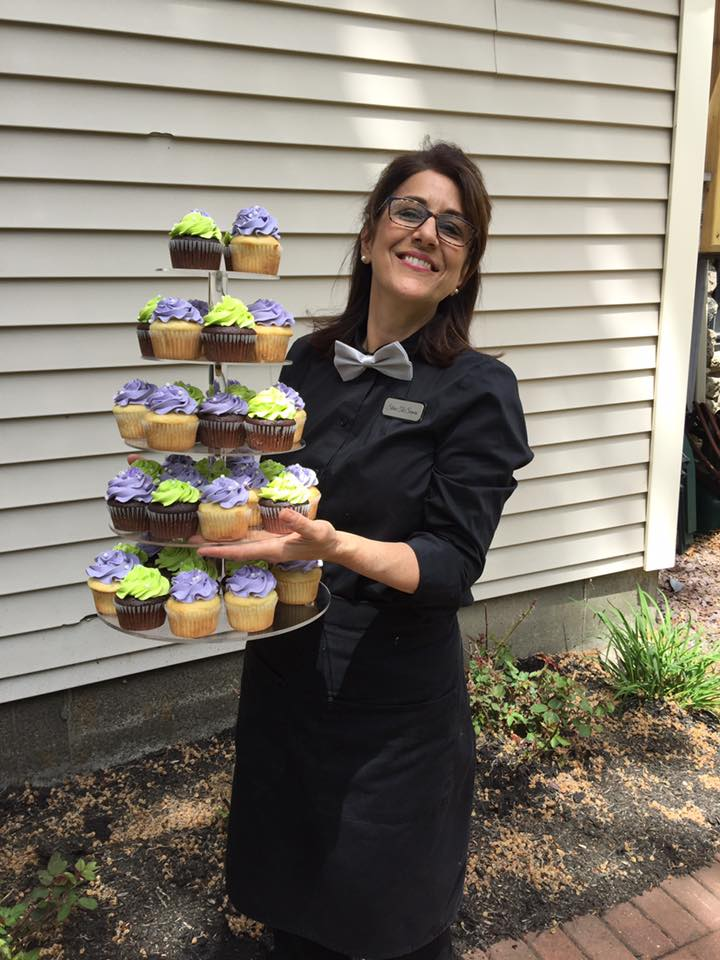 Our founder ready to serve some cupcakes!