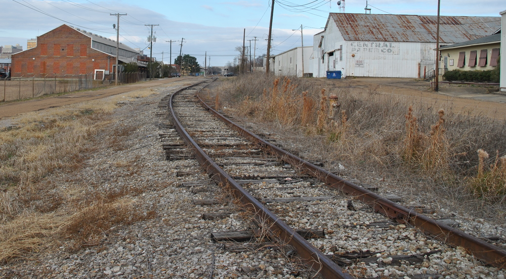 Old railroad buildings line the rails no one has pulled up for scrap. PROTIP: Steel sells!