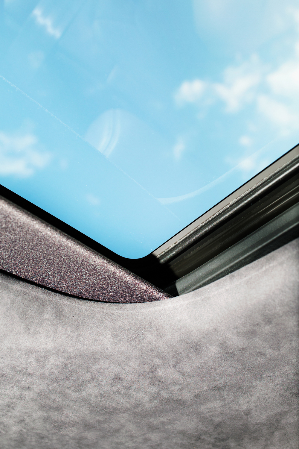 kate owen w mag magazine lincoln cars detail shot sky suede sunroof