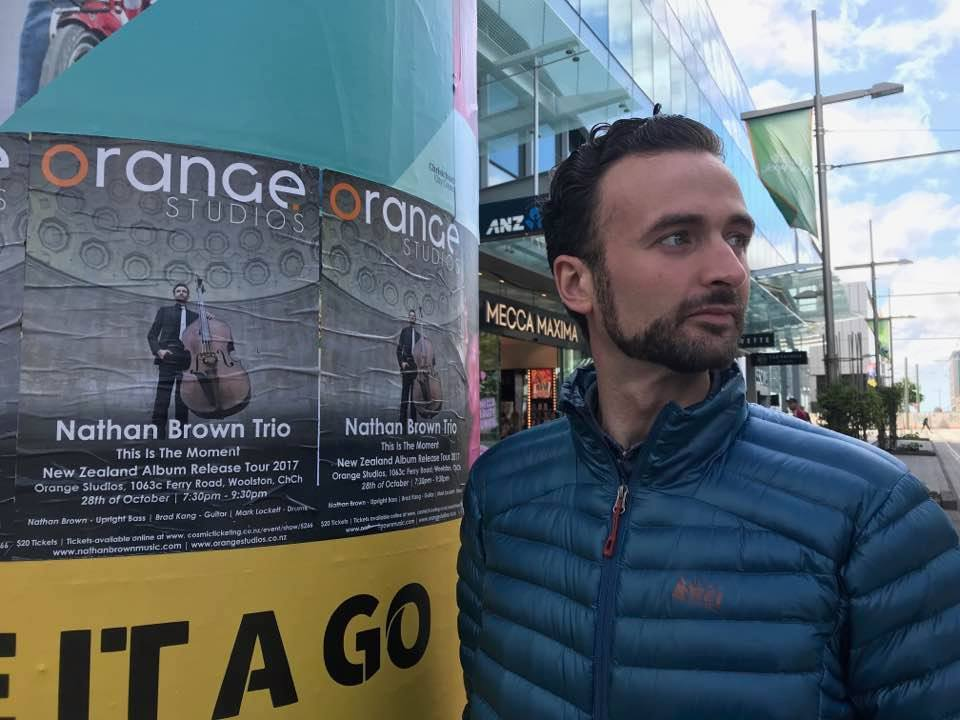 Nathan next to posters that were put up around Christchurch NZ