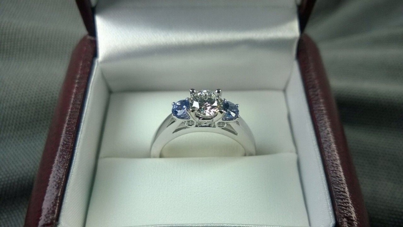 Kira's custom designed white gold, diamond and tanzanite engagement ring, with a round, brilliant cut is from Lugaro Jewellers in Victoria, BC.