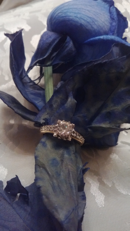 My mum's custom yellow gold, princess diamond cut engagement ring. Designed in Toronto, ON by an independent jeweller.