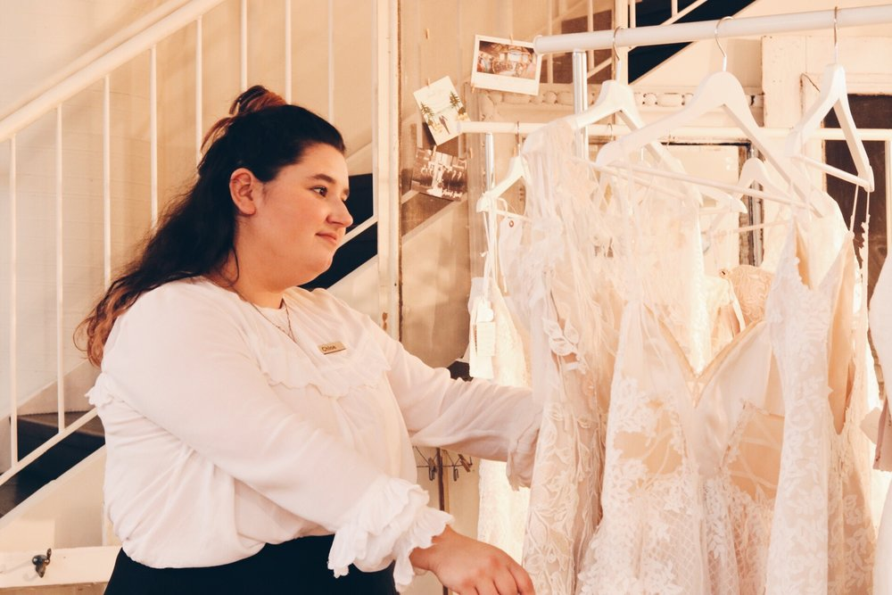 Meet Chloe - What made you start working in the bridal industry?I loved the idea of helping people find something that made them feel beautiful no matter what age, budget or body type for their big day. It's really wonderful to be a part of the experience and to make sure finding the perfect dress easy, fun and a very special memory.  What is your Favourite Dress in store? I'm really excited for the new Lis Simon collection but my fave dress right now is the Ina or the L'amour sweetheart ball gown . What is your favourite 2017 wedding trend?Super simple and elegant fabrics. What is your Guilty Pleasure?Binge watching tv shows. Are you a dog or a cat person?Both! I have 3 dogs and a cat so it's safe to say I'm an animal person. What is your favourite thing to do to unwindKnitting, Baking and watching Rupaul's Drag Race.  What is your winter essential?Blanket scarf and chapstick!