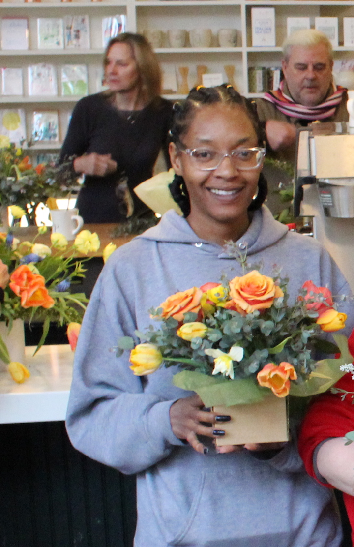 Shayla holding a boquet she created at a recent London Plane / PwA flower making workshop.