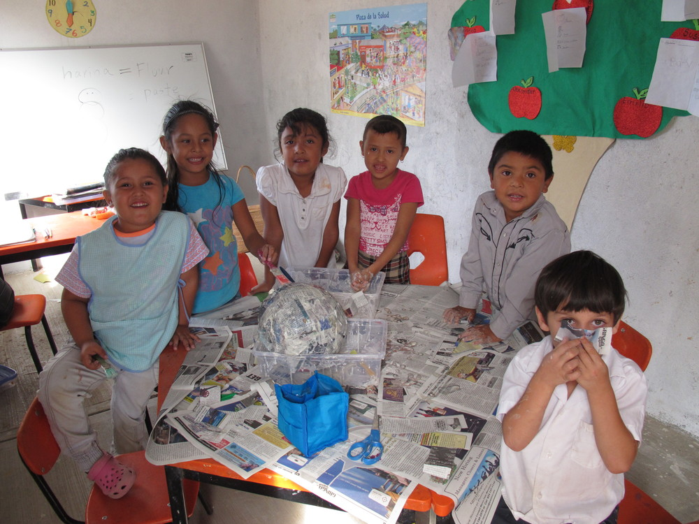 The kids working on a papier maché snowman for their Posada (Christmas party.)