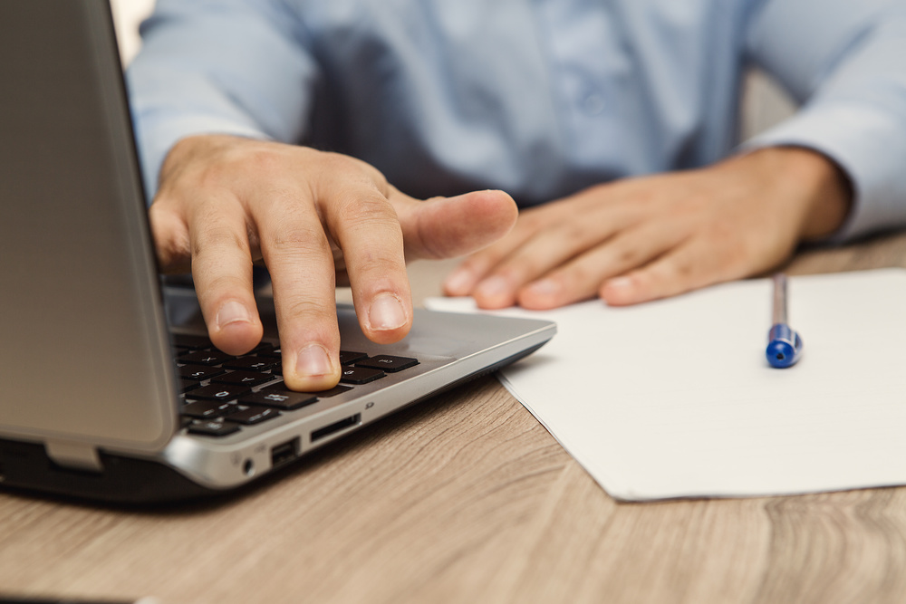 property manager typing on laptop