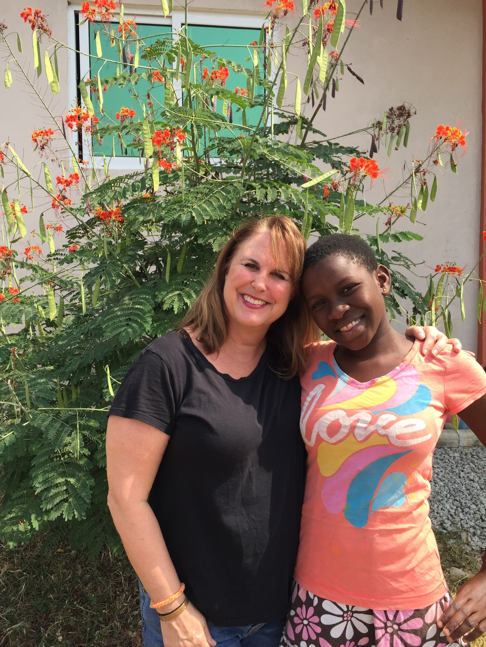 Jonna with Benedicta, the child she has sponsored for three years.