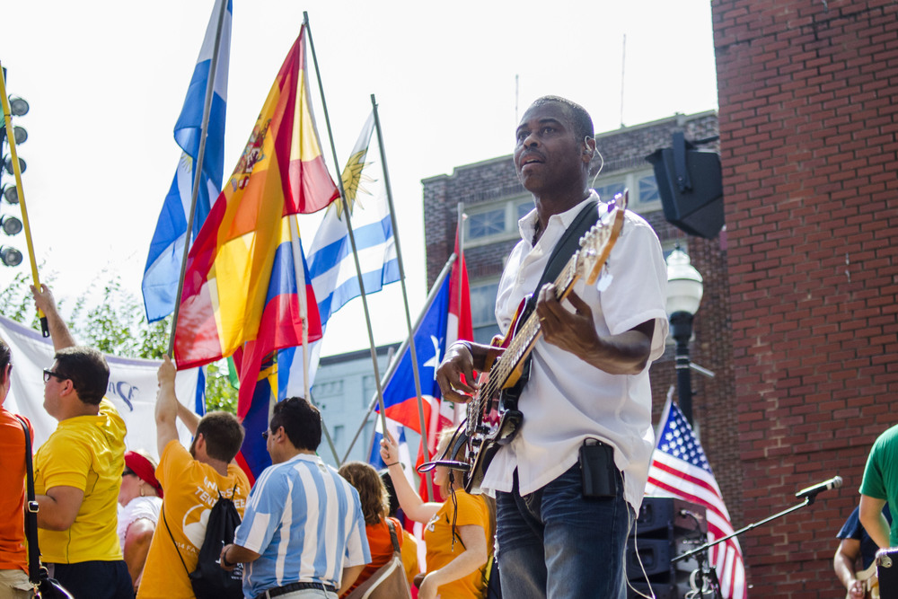 Bass player, Joe Florence, warms up for his performance following the Parade of Nations.