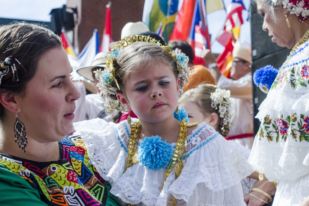 Katerina Keck, 4, held by her mother, Ana Keck, is dressed in traditional Spanish clothing and accessories after a group photo on the steps of Market Square's amphitheater.