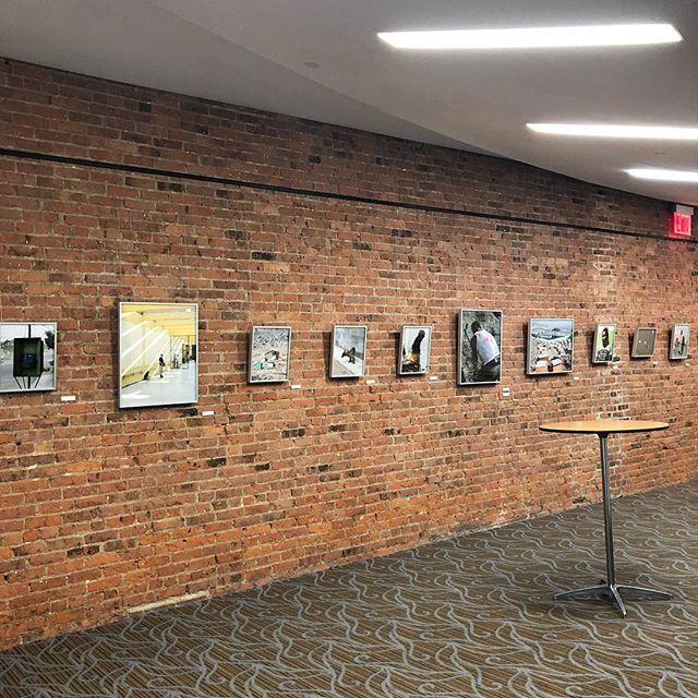"Getting set up for the ""Beyond Bars"" opening reception! Starts at 6:30 tonight, we hope to see you soon. . . . In Carlos Jaramillo's latest exhibit he explores life inside and outside of Lurigancho, a prison in Lima, Peru. His photographs capture the similarities between society on ""el cerro,"" the hill, and life inside the prison. Life that rises from the rubble above the prison echoes the life inside its walls, and Jaramillo attempts to uncover what it is that informs the hope felt by prisoners and civilians. #openingreception #nycart #nycphotographer"