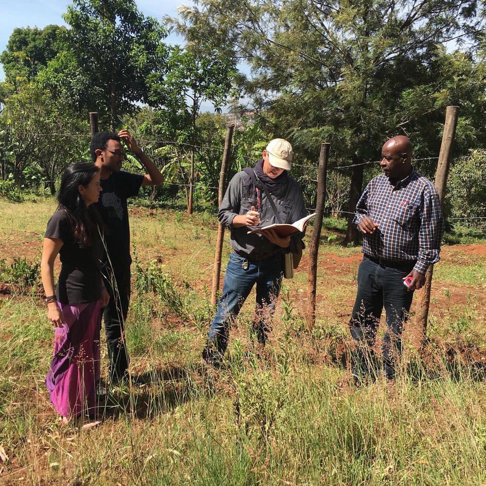 Warren, Jennifer, Henok, and Daniel doing survey & design work at the Wolayta Village Building site.