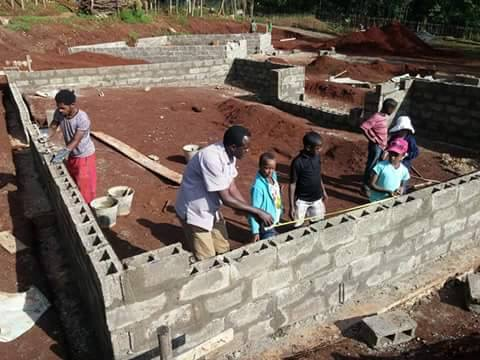 Project Manager Terefe working with our children to build their new home!