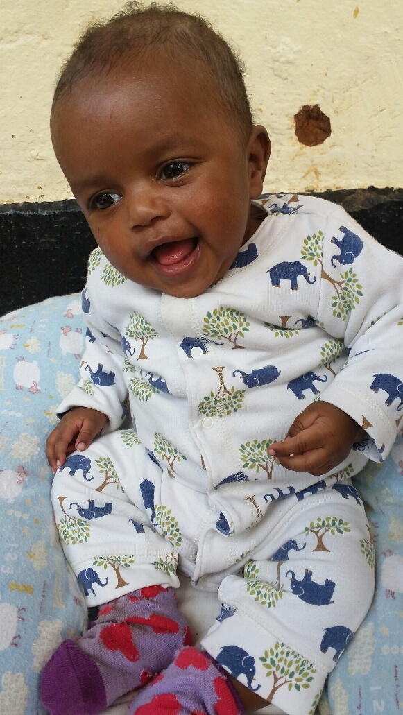 Edigatu  Edigatu came to us after being found in a ditch as a newborn, a day or two old. He was so tiny and helpless, but now he is sitting up, eating like a champ, and full of smiles and giggles! Edigatu is generously sponsored by Steve and Cindy Bond.