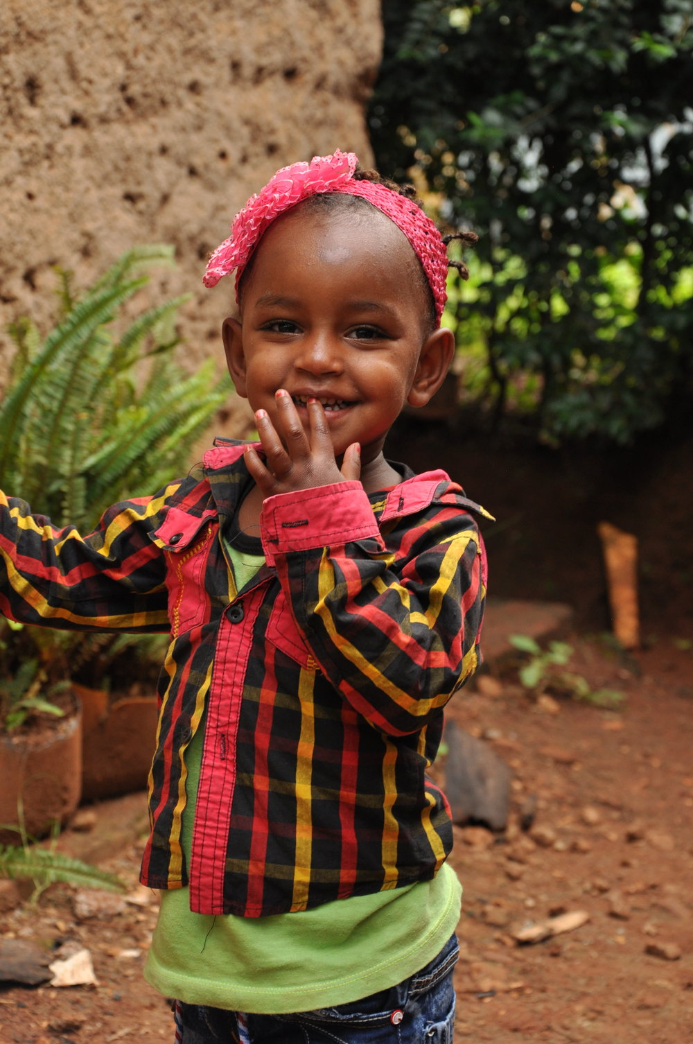 """Alamitu   Alamitu came to us after her previous orphanage shut down due to lack of funding. She is an adorable little girl, and as you can see, sassy as can be! Alamitu is generously sponsored by Darren """"Dagwood"""" Roberts."""