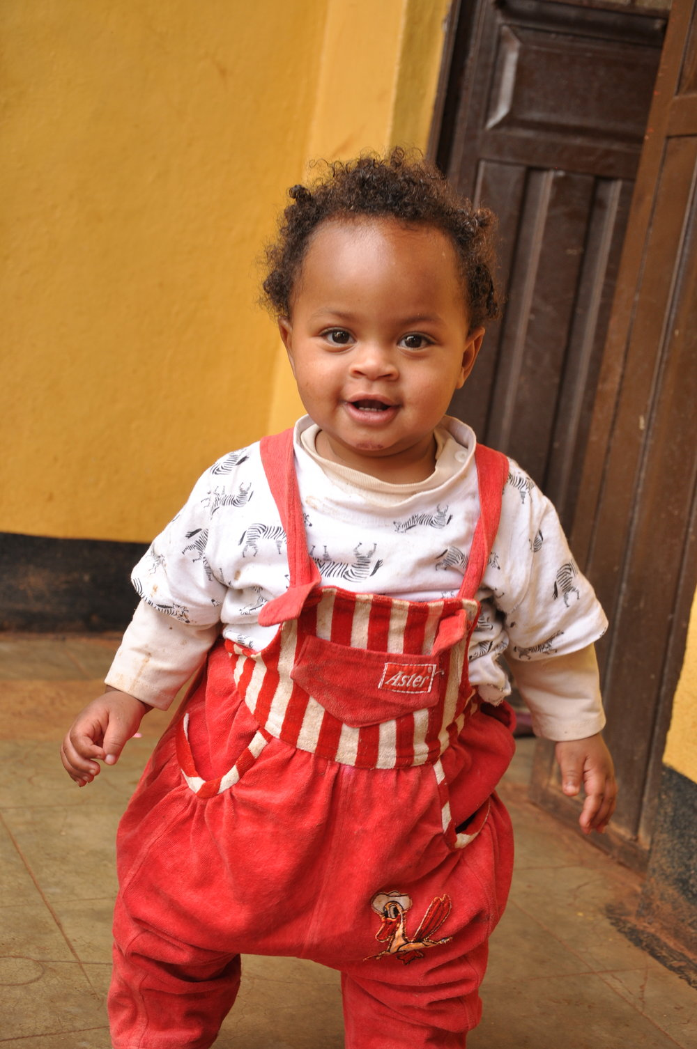 Edigatua  Edigatua came to us as a tiny, fragile newborn. She is a wide eyed, smiley, chubby baby girl now, and very curious about everything around her. Edigatua is generously sponsored by Dick and Francie Carvin.