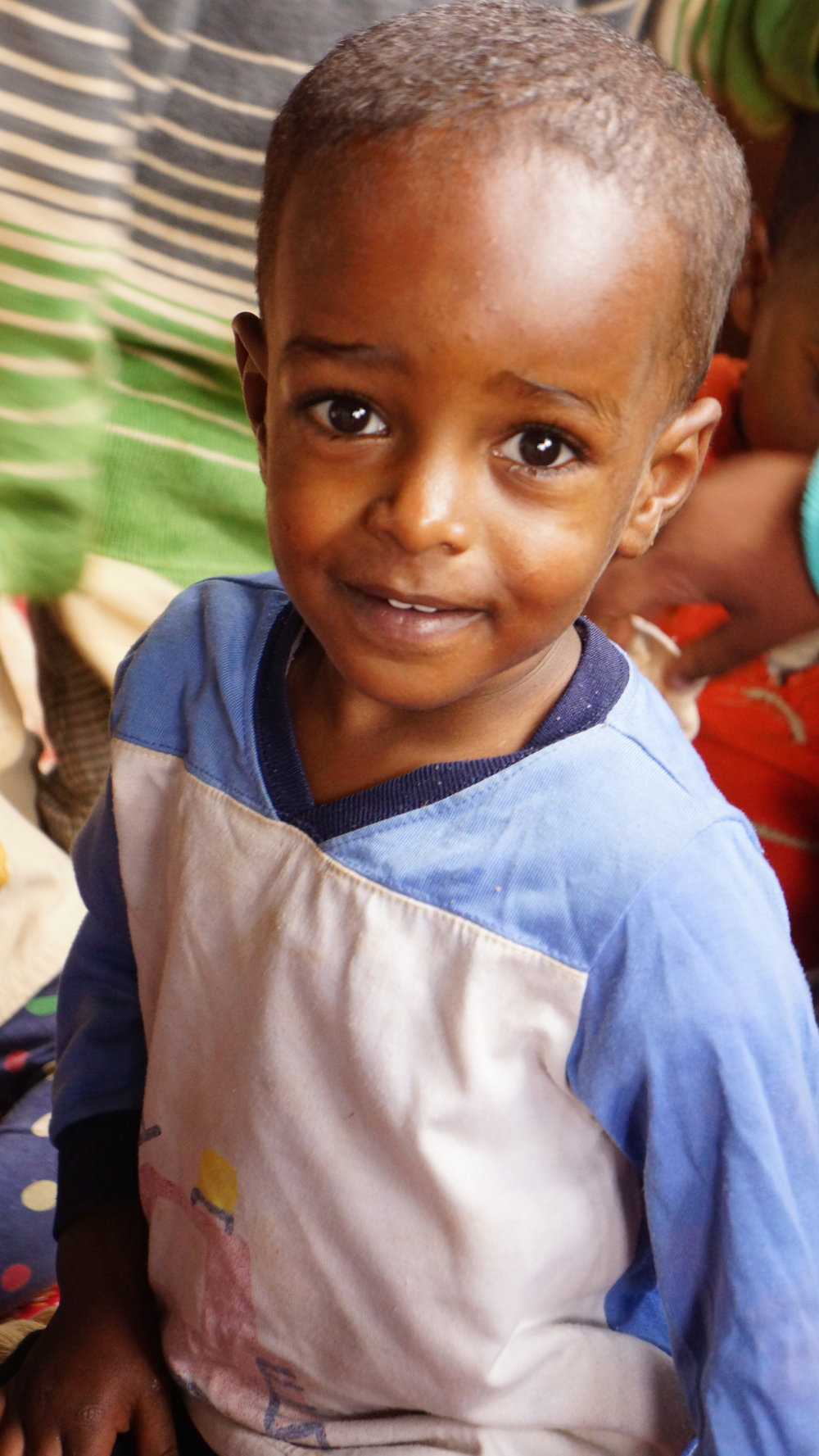 Mhiratu   Mhiratu came to us after his orphanage shut down due to lack of funding. He is a sweet, shy little boy, and is now walking and learning to talk,and becoming more outgoing every day. Mhiratu is generously sponsored by Ashlee Bond.