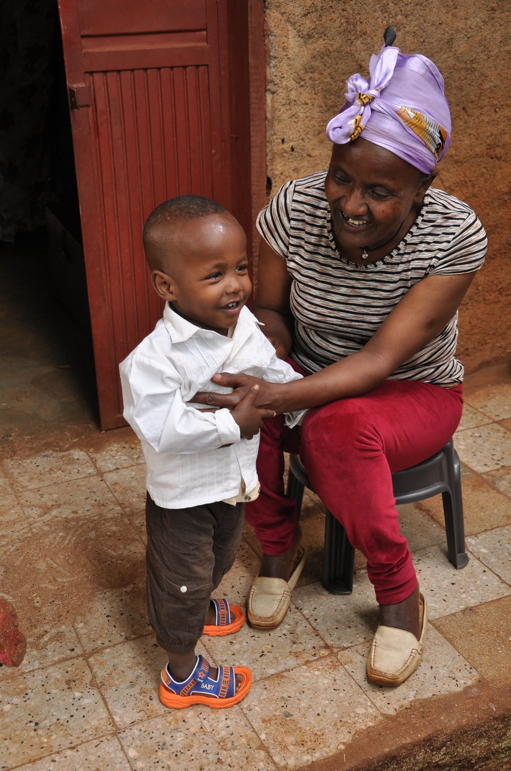 Yhune with his new mother, an older lady who just treats him like gold.