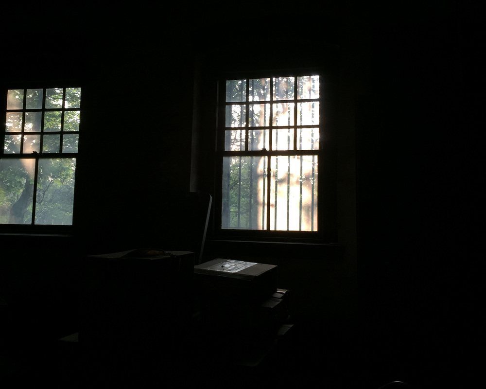 The filtered light through these windows created the shadowy effect that you see in the first two images.