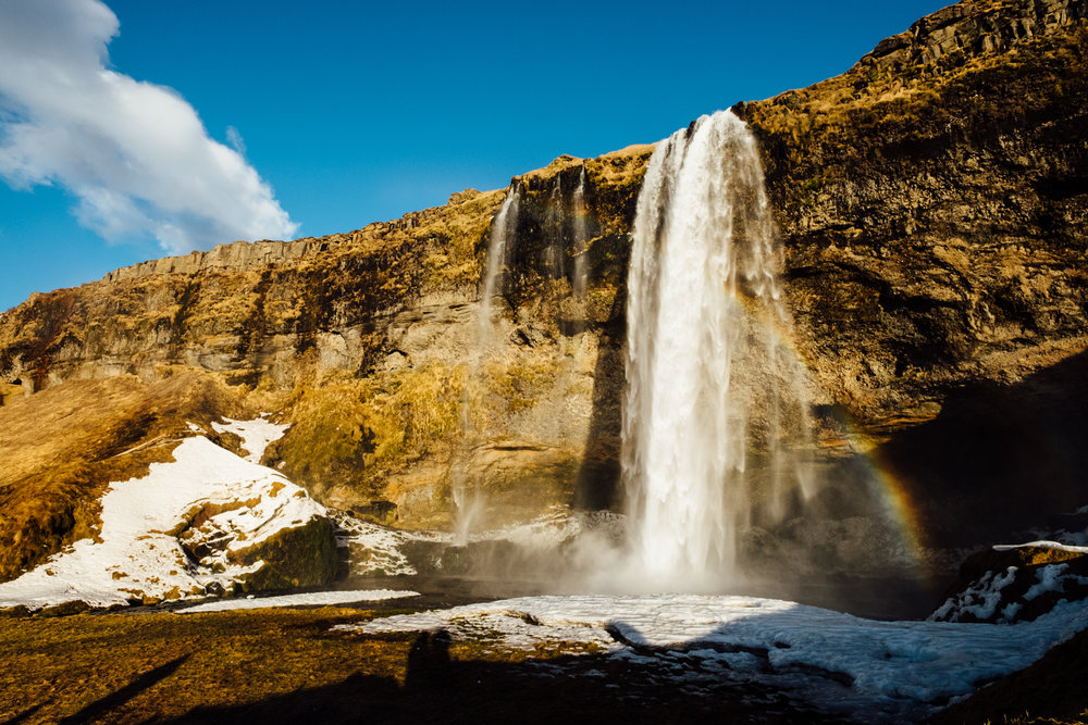 Our first stop was the Seljalandsfoss waterfall. We arrived here right as the sun was setting, so the light couldn't have been more beautiful - a huge change from the cloudy weather that greeted us when our plane landed just a few hours prior. This waterfall is popular due to its accessibility, and during the summer months you can walk behind it (unfortunately that walkway was closed when we were there).