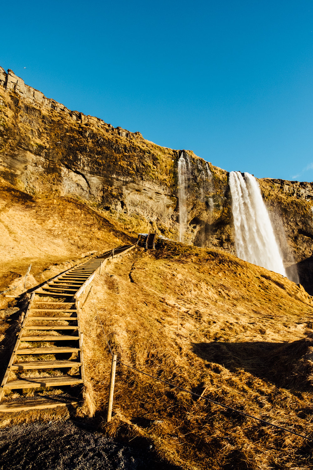 The stairs leading up to the waterfall. We were so lucky to experience some sunshine on our first day in Iceland. It's pretty rare all year round, but especially in winter.