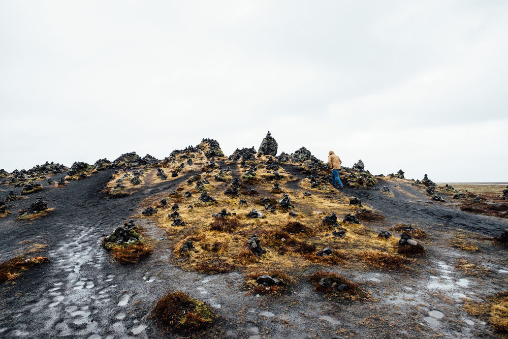 This lava mound is said to have been created after the destruction of the Laufskalar farm after the eruption of  Katla - Iceland's most dangerous volcano that is due to erupt again any day now - in 894. It was tradition for travelers passing through this area to add a stone to the cairns for good luck. Disturbing the landscape to build more cairns is frowned upon now, but it's still astonishing to see the hundreds of little rock sculptures all around you.