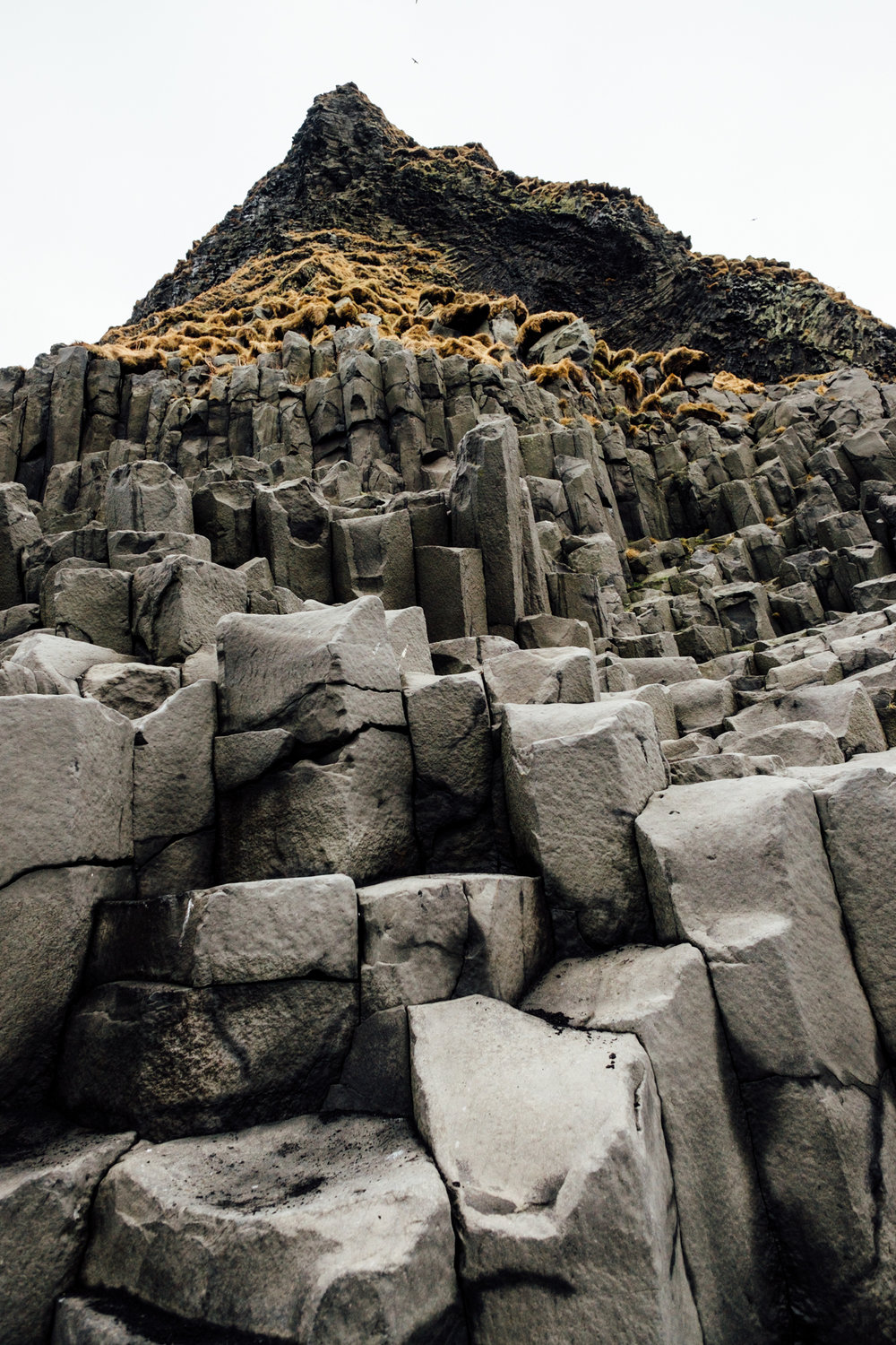 A better view of the basalt columns at Reynisfjara. The columns are formed by  fractures from slow-cooling lava.