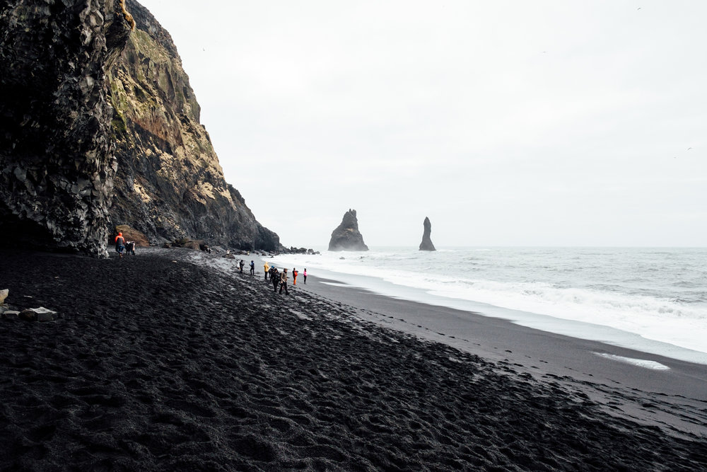 Looking Eastward down the beach towards Reynisdrangar, large rock formations just off the shore in Vik. These rocks are home to a ton of birds, including Puffins in the summer!
