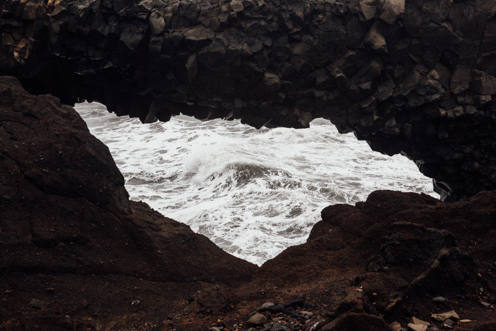 Looking through the Dyrhólaey arch at the waves.