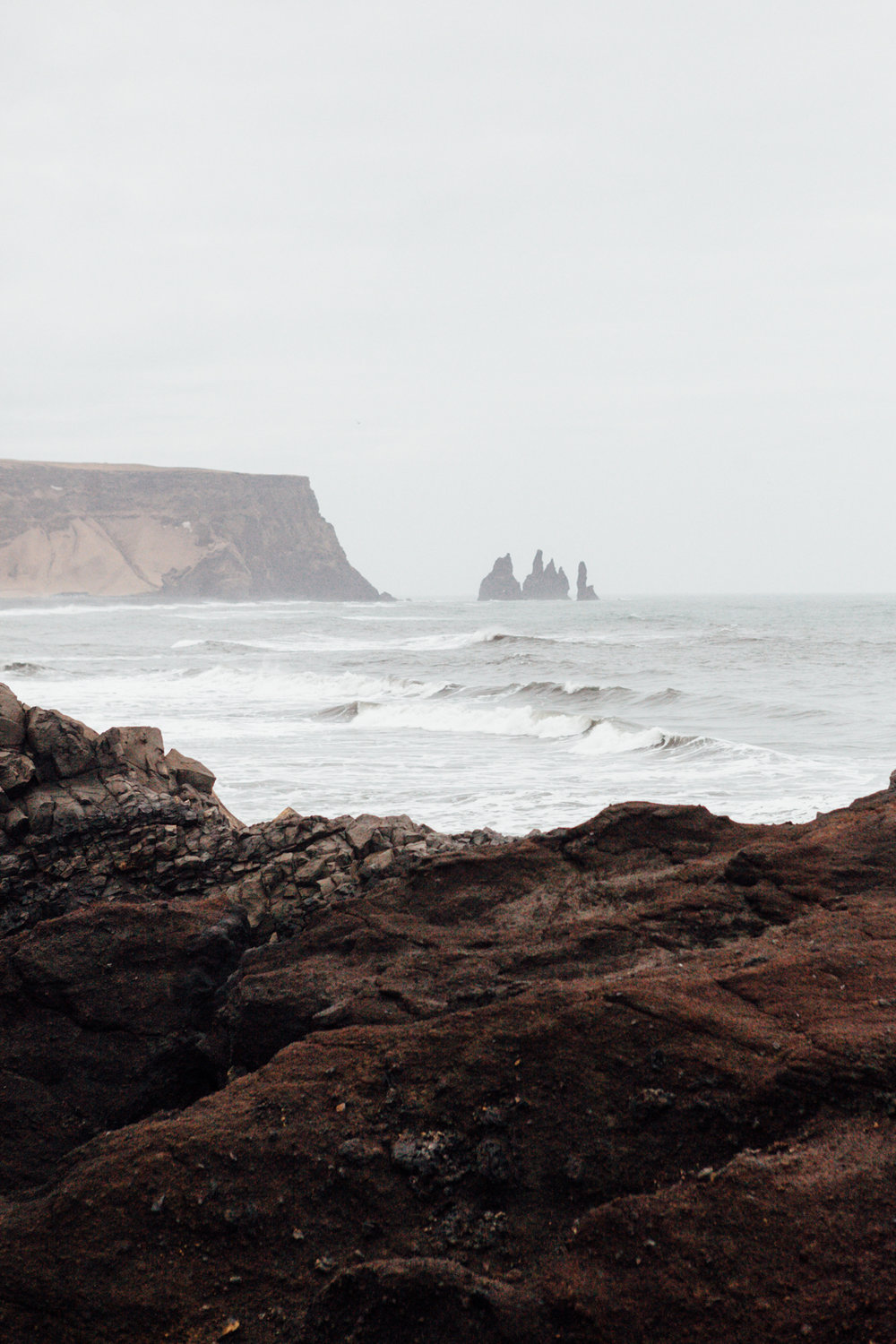 A distance view of Reynisdrangar from the Dyrhólaey Peninsula.