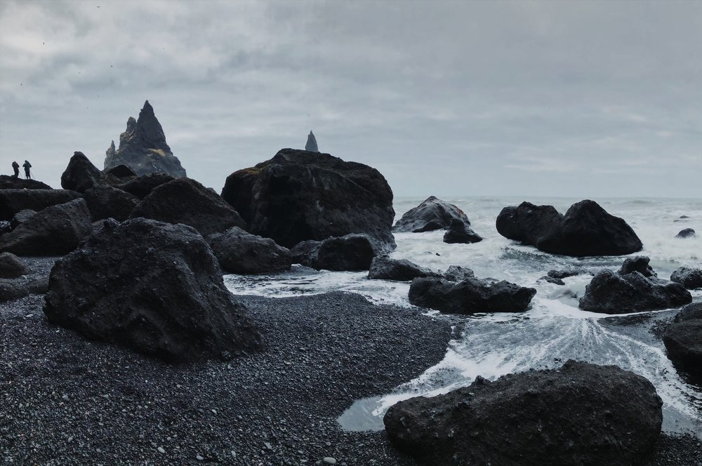 A moody phone shot of the black sand beach in Vik.