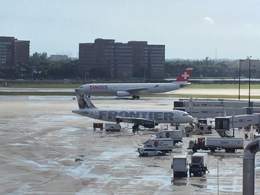 A Swissair A330 taxiing past a Frontier A320
