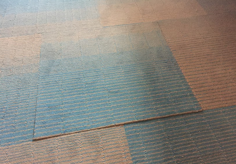Our room had an unsecured carpet tile