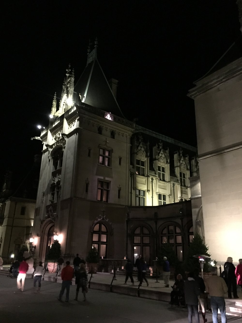 The front of Biltmore House is brightly lit at night. (click to enlarge)