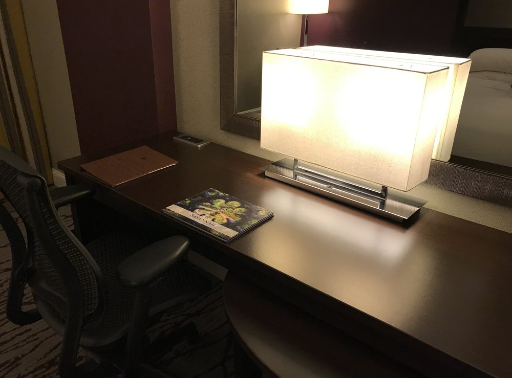 Desk with contemporary lamp