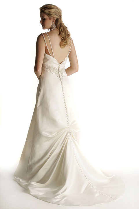 Strapless with dropped waist. Low basque waistline enhanced with crystals. Pyramid of beaded embroidery on front of skirt. Matching veil.