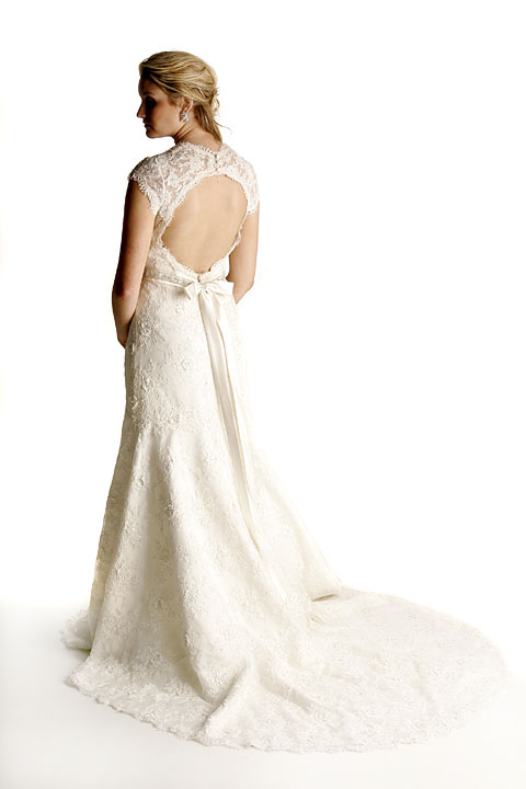 All Alencon lace, cap sleeve, sweetheart neckline, beaded natural waistline, dramatic key-hole open back, chapel train. Matching veil.