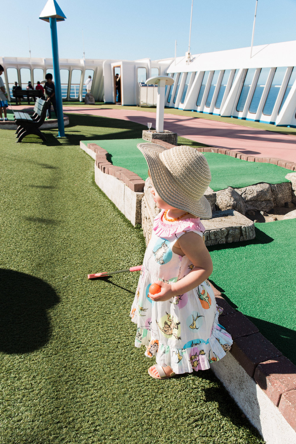 """A little family game of mini golf before her """"Suess at Sea"""" story time."""