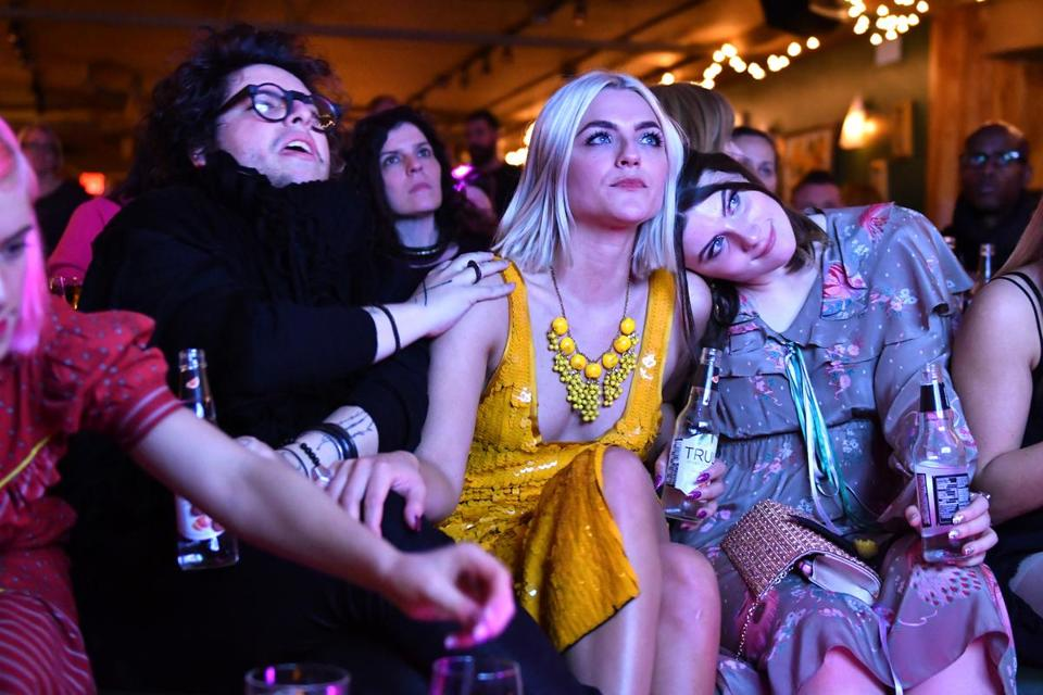 Project Runway finalist Erin Robertson, center, with Christian Restrepo, left, and Michaela Bosch during the watch party at Capo in South Boston Thursday night.