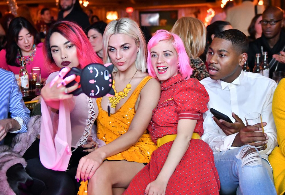 From left, Nathalia JMag, Robertson, Jordan Pianedosi, and Cornelius Ortiz photographed themselves during Thursday's watch party.