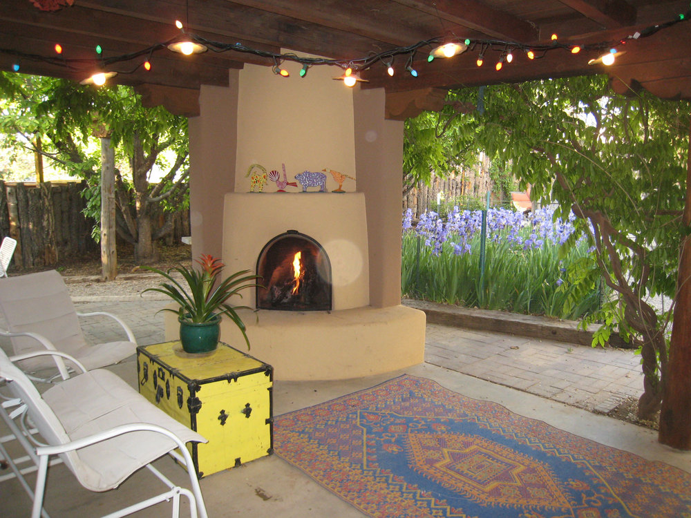 Kiva fireplace on portale overlooking garden