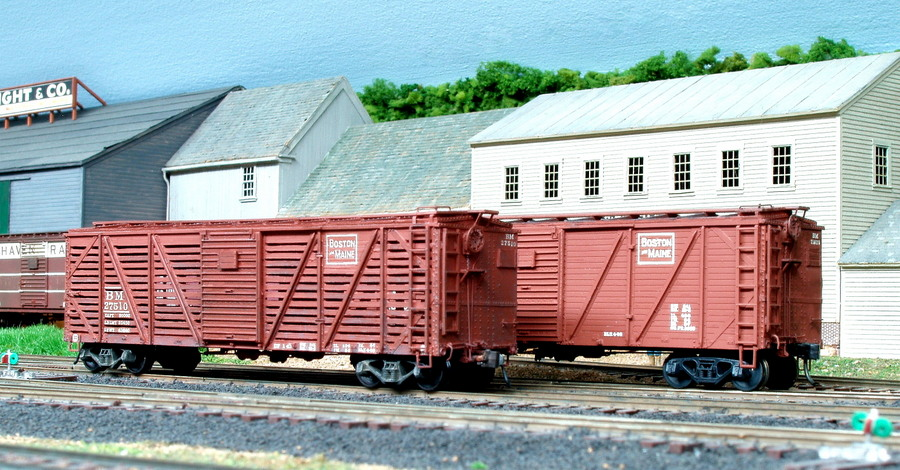 In 1945, the B&M converted 15 of its single sheathed boxcars into stock cars.  Standing behind 27510 is one of the type of cars converted by removing side boards.  Both built by Edward J. Ozog from F&C Kits. Photographed and submitted by Mr. Ozog. Photo 793