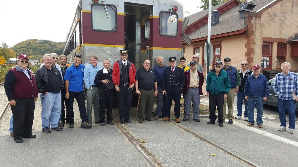 Crowd of B&MRRHS members assembles to meet and greet the crew Winnipesaukee Scenic Railroad autumn foliage excursion train at Plymouth, N.H. , October 15, 2016. Chuck Spence photo.
