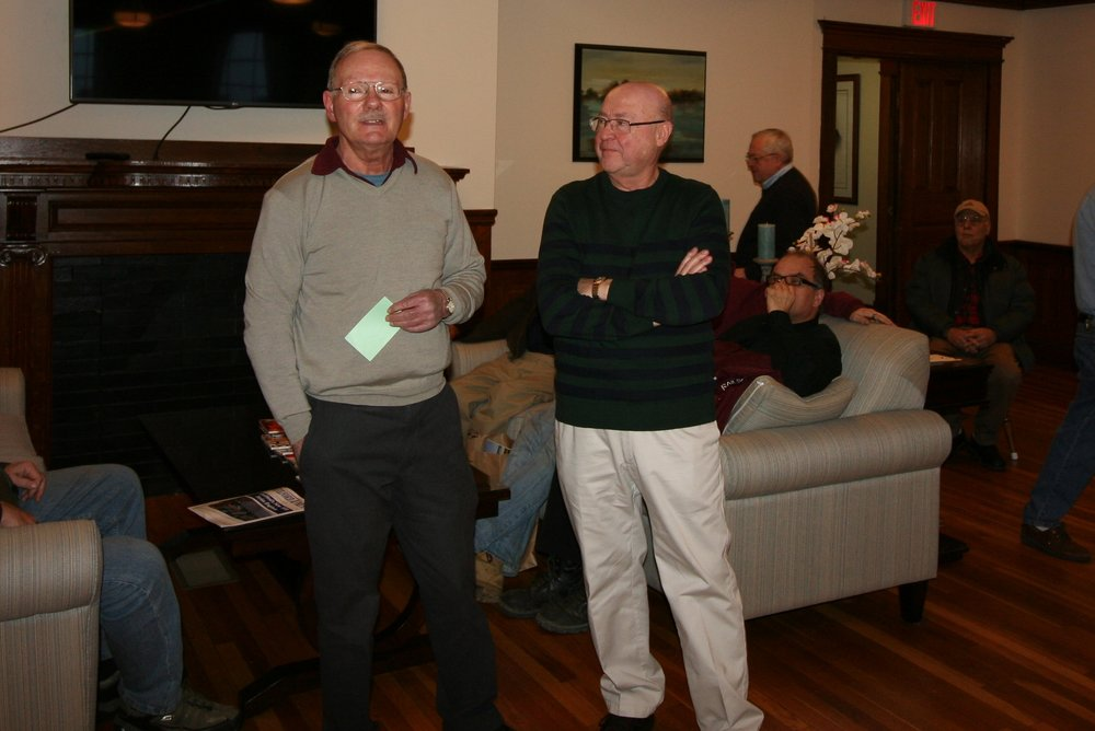 B&MRRHS director and program co-chairman Mal Sockol (left)  introduces retired B&M and Amtrak dispatcher Carl Senftleben to the members at Rogers Hall on January 14, 2017. (Rick Nowell photo)
