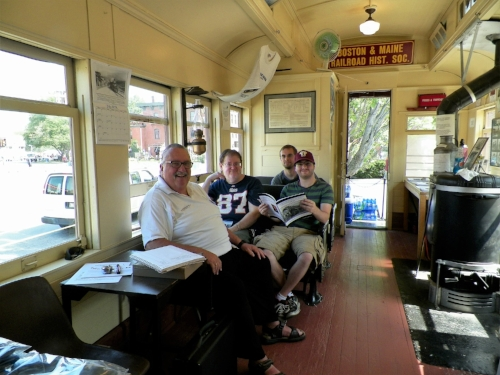"B&MRRHS Chairman Paul T. Kosciolek and visiting ""passengers"" enjoy the ambiance of Combine No. 1244 at the 2018 Lowell Folk Festival. Richard Nichols photo"